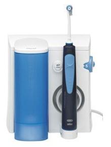 Higiene bucal con irrigador bucal o waterpick. Tratamientos de odontología conservadora